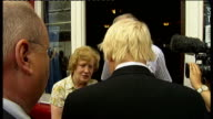 Boris Johnson and Eric Pickles on tour of Tottenham Boris along t to meet landlord and landlady outside Victoria pub / Boris chatting with local at...
