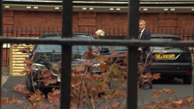 London EXT Boris Johnson MP along out of residence with red ministerial case and into car / car driving away