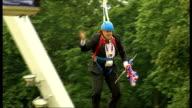 Boris Johnson gets stuck on zip wire ENGLAND London Victoria Park EXT Boris Johnson along down zipwire waving Union Jack flags Johnson along on zip...