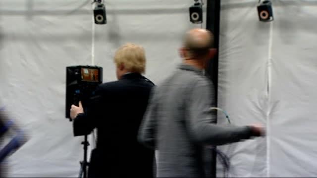 Boris Johnson visits Ealing Studios **music soundtrack heard over following** Boris Johnson filming avatar computer screen in film studio