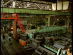 Boris Yeltsin visit to London RUSSIA TGV Engineering plant PAN MS Workers with hot iron bars BV Worker welding MS Machinery being lifted CMS Workers