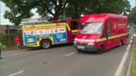Emergency services at scene ENGLAND Cheshire Bosley EXT Midlands Air Ambulance landing / fire fighters on road with fuire engine parked nearby /...