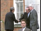 Peace plan reaction ENGLAND Kent Chevening BV Warren Christopher out of car PAN LR as shakes hands with Douglas Hurd and Malcolm Rifkind and Hurd...