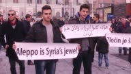 Bosnian people gather to protest Assad regime forces' and its supporters' attacks on civilians and the humanitarian plight in Aleppo on December 14...