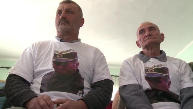 Bosnian Serb veterans watch a live broadcast of UN judges sentencing former Bosnian Serbian commander Ratko Mladic to life imprisonment after finding...