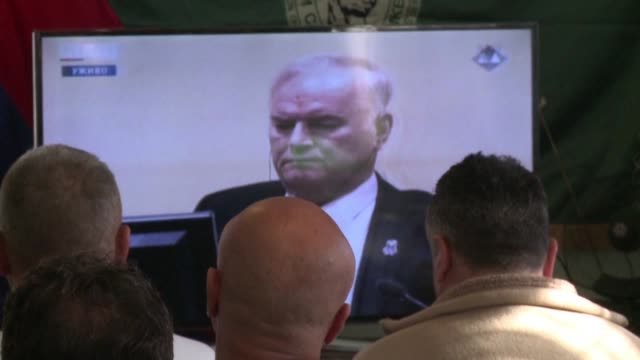 Bosnian Serb veterans watch the verdict against Ratko Mladic broadcast live in the Bosnian village of Sokolac