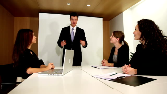 Boss shares good news in business meeting