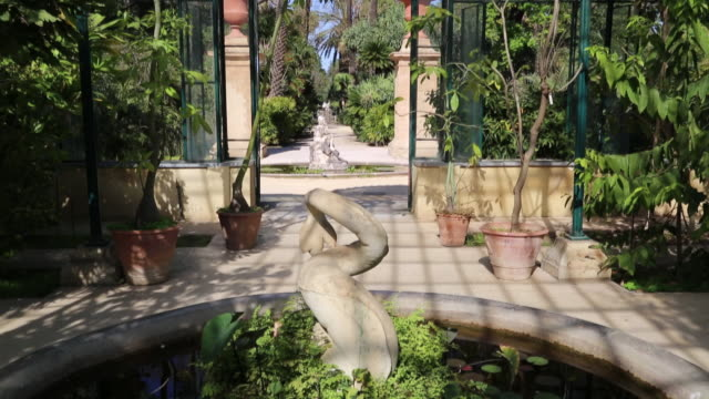 Botanical gardens (Orto Botanico di Palermo), view of the winter greenhouse gardens with a fountain, Palermo, Sicily
