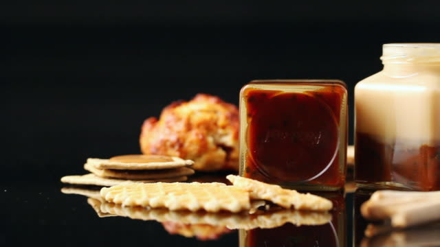 CU PAN Bottle of jam and cookies and bread in black backdrop / Seoul, South Korea