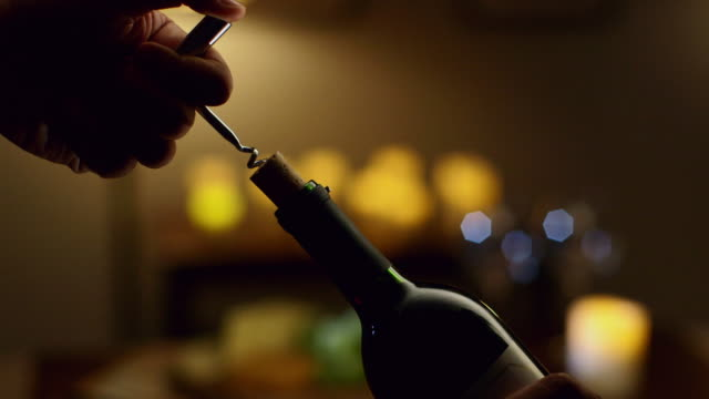 CU bottle of wine being opened