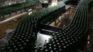 Bottles and crates of Heineken beer and Amstel Pilsner beer move along the production line at the Heineken NV brewery in Saint Petersburg Russia on...