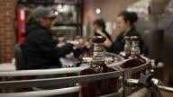 Bottles move down a conveyor belt on the Jack Daniel's Single Barrel Select Tennessee Whiskey bottling line at Jack Daniel's Distillery in Lynchburg...