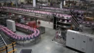 Bottles of Evian water move along the production line at the new Evian mineral water bottling plant owned by Danone SA near Evian France on Tuesday...