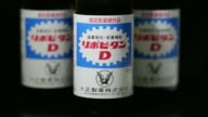 Bottles of Taisho Pharmaceutical Cos Lipovitan D energy drink are arranged for a shot in Tokyo Japan on Monday July 21 A bottle of Taisho...