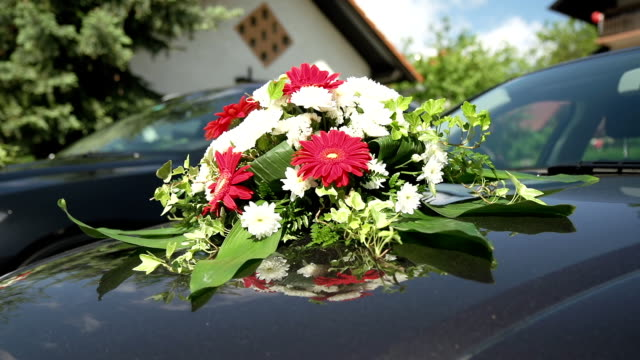 HD DOLLY: Bouquet On A Car Hood