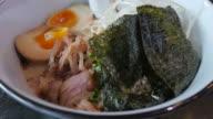 A bowl of Japanese Ramen Close up.
