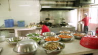 MS PAN Bowls of food in kitchen / Shenzhen, Guangdong, China