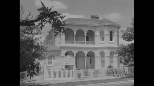 ext Salvation Army Home for Boys Howard House sign / ext house anon boy on balcony / wide shot ext 2 storey Howard House / ext suburban weatherboard...