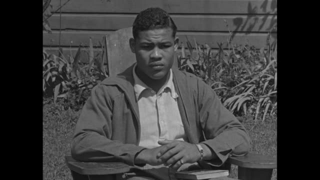 VS boxer Joe Louis seated in adirondack chair with Great Dane laying beside him / SOT 'Max Baer stands in my way for a chance to the title so I'm...