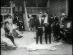 B/W 1914 boxer knocking man down stairs + running down stairs + disrupting fancy party / feature