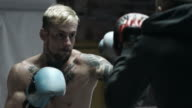 Boxer sparring with trainer