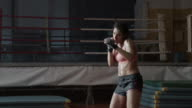 Boxer woman training. Shadowboxing.