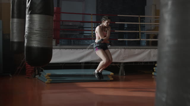 Boxer woman warm-up, jumping rope