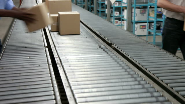Boxes Coming Off a Conveyor Belt