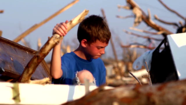 Boy alone after a natural disaster