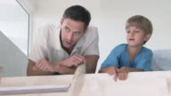 Boy and father talking