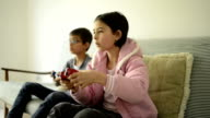 Boy and girl play video game