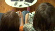CU, HA, Boy (8-9) and girl (10-11) playing video game