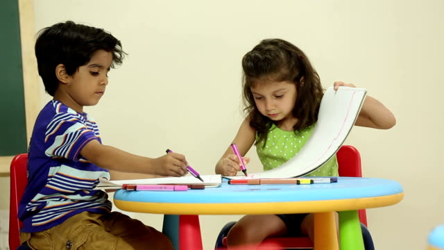 Boy and girl studying at school