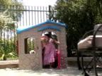 MS, Boy (2-3) and girl (4-5) walking in garden, Simi Valley, California, USA