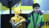 MS ZO WS Boy and robot at exhibition, Tokyo, Japan