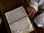 MS ZO HA Boy and teacher reading Koran, Shitral Valley, North West Province, Pakistan