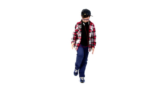 Boy dancing on white background