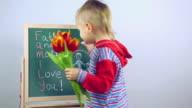 boy draws a card for parents