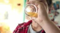 Boy drinking glass of orange juice