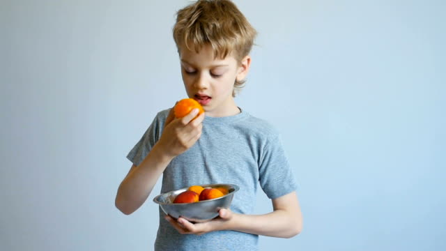 boy eating a peach