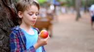 boy eating an apple, close up