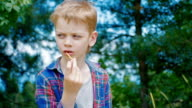 Boy eating salty sticks, close up