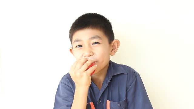 Boy eats apple