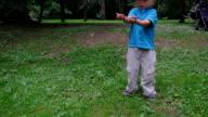 Boy feeding a squirrel