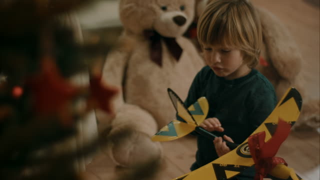 Boy gets toy plane for christmas