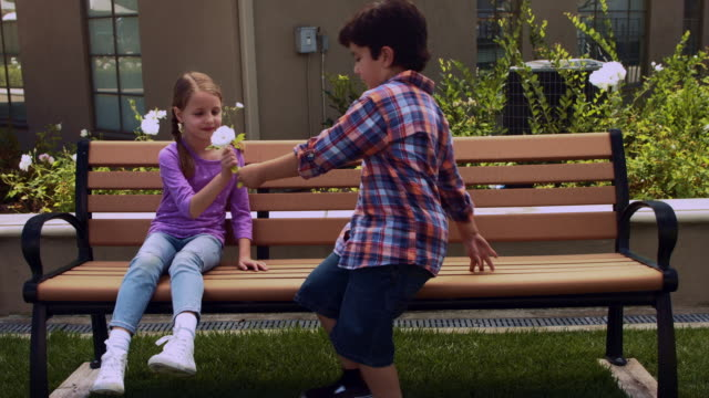 WS boy gives girl a flower