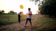 Boy, his dog and balloon