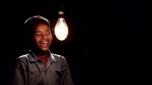Boy illuminated a electric bulb