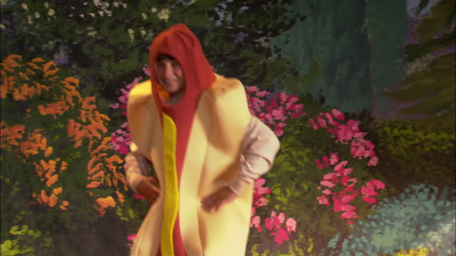 Boy in hot dog costume dancing on stage / Los Angeles, California