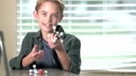 Boy in science class talking about molecule model